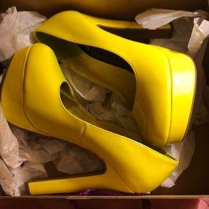 Yellow platform heels five inches